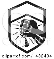 Retro Clenched Fist Holding Military Dog Tags In A Black And White Crest