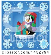 Clipart Of A Christmas Penguin Holding A Gift Inside A Blue Snowflake Frame Royalty Free Vector Illustration