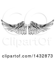 Clipart Of A Black And White Pair Of Feathered Wings In Woodcut Style Royalty Free Vector Illustration