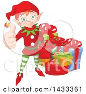 Clipart Of A Happy Christmas Elf Giving A Thumb Up By Gifts Royalty Free Vector Illustration by Pushkin
