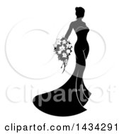 Silhouetted Black And White Bride Posing In A Wedding Gown With A Bouquet