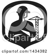 Clipart Of A Retro Silhouetted Builder Engineer Or Foreman With Folded Arms In A A Shield With A Construction Crane Royalty Free Vector Illustration