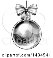 Clipart Of A Black And White Vintage Woodcut Or Engraved Suspended Christmas Bauble Ornament With A Bow Royalty Free Vector Illustration