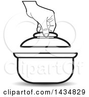 Clipart Of A Black And White Hand Lifting The Lid On A Sauce Pan Royalty Free Vector Illustration