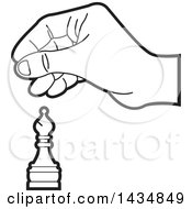 Black And White Hand Moving A Bishop Chess Piece