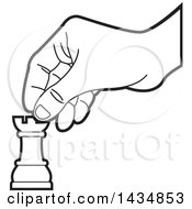 Clipart Of A Black And White Hand Moving A Rook Chess Piece Royalty Free Vector Illustration