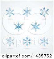 Clipart Of Blue Snowflakes And Shadows Royalty Free Vector Illustration