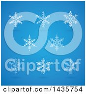 Clipart Of White Snowflakes With Shadows On Blue Royalty Free Vector Illustration by cidepix