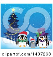 Clipart Of Christmas Penguins By A Tree Royalty Free Vector Illustration
