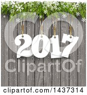 Clipart Of A New Year 2017 Design With Numbers Hanging From Branches With Snowflakes Over Wood Royalty Free Vector Illustration