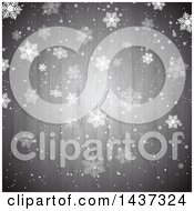 Clipart Of A Christmas Background With Winter Snowflakes Over Gray Wood Royalty Free Vector Illustration