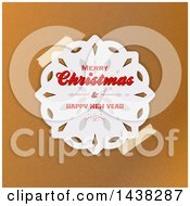 Taped Merry Christmas And Happy New Year Greeting Paper Snowflake Over Brown Paper