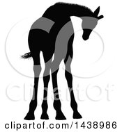 Clipart Of A Black Silhouetted Giraffe Royalty Free Vector Illustration by AtStockIllustration