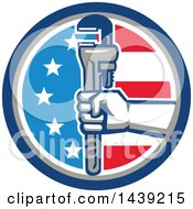 Clipart Of A Retro Plumber Hand Holding A Pipe Monkey Wrench In An American Circle Royalty Free Vector Illustration
