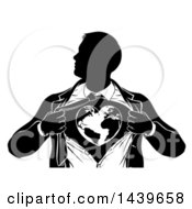 Clipart Of A Black And White Silhouetted Strong Business Man Super Hero Ripping Off His Suit And Revealing A Heart Earth Royalty Free Vector Illustration