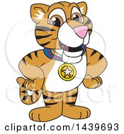 Clipart Of A Tiger Cub School Mascot Character Wearing A Sports Medal Royalty Free Vector Illustration