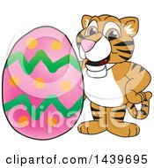 Clipart Of A Tiger Cub School Mascot Character With An Easter Egg Royalty Free Vector Illustration