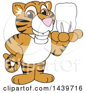 Clipart Of A Tiger Cub School Mascot Character Holding A Tooth Royalty Free Vector Illustration by Toons4Biz