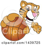 Clipart Of A Tiger Cub School Mascot Character Grabbing A Basketball Royalty Free Vector Illustration by Toons4Biz