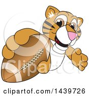 Clipart Of A Tiger Cub School Mascot Character Grabbing A Football Royalty Free Vector Illustration by Toons4Biz
