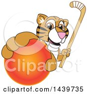 Tiger Cub School Mascot Character Grabbing A Hockey Ball And Holding A Stick