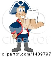 Patriot School Mascot Character Holding A Tooth
