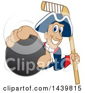 Patriot School Mascot Character Grabbing A Hockey Puck And Holding A Stick