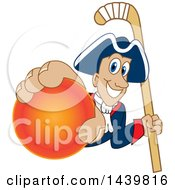 Patriot School Mascot Character Grabbing A Field Hockey Ball And Holding A Stick