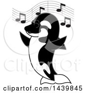 Clipart Of A Killer Whale Orca School Mascot Character Singing Royalty Free Vector Illustration by Toons4Biz