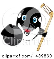 Killer Whale Orca School Mascot Character Grabbing A Hockey Puck And Holding A Stick