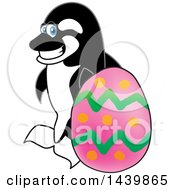 Clipart Of A Killer Whale Orca School Mascot Character With An Easter Egg Royalty Free Vector Illustration by Toons4Biz