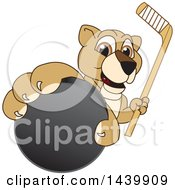 Lion Cub School Mascot Character Grabbing A Hockey Puck And Holding A Stick