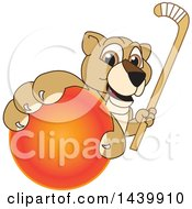 Lion Cub School Mascot Character Grabbing A Hockey Ball And Holding A Stick