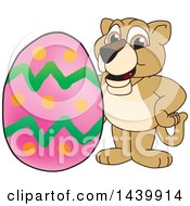 Clipart Of A Lion Cub School Mascot Character With An Easter Egg Royalty Free Vector Illustration by Toons4Biz