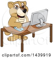 Lion Cub School Mascot Character Using A Computer