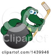 Gator School Mascot Character Grabbing A Hockey Puck And Holding A Stick
