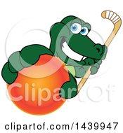 Gator School Mascot Character Grabbing A Field Hockey Ball And Holding A Stick