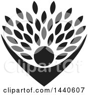 Clipart Of A Black Silhouetted Cheering Person Holding Up Leaves Royalty Free Vector Illustration
