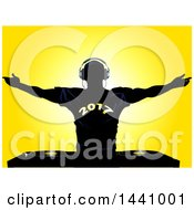 Clipart Of A Black Silhouetted Male DJ Holding His Arms Up Wearing A 2017 New Year Shirt Over Record Decks On Yellow Royalty Free Vector Illustration