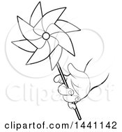 Black And White Lineart Childs Hand Holding A Spinning Pinwheel