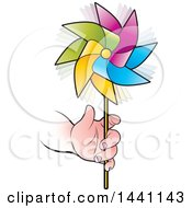 Clipart Of A Childs Hand Holding A Colorful Spinning Pinwheel Royalty Free Vector Illustration by Lal Perera