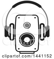 Clipart Of A Black And White Pair Of Headphones And A Speaker Royalty Free Vector Illustration by Lal Perera