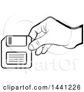 Clipart Of A Black And White Hand Holding A Floppy Disk Royalty Free Vector Illustration