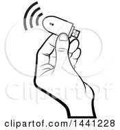 Black And White Hand Holding A Computer Wireless Usb Modem