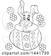 Black And White Lineart Happy Easter Bunny Rabbit Resting On A Giant Egg