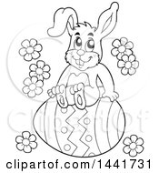 Black And White Lineart Happy Easter Bunny Rabbit Sitting On A Giant Egg