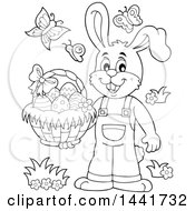 Clipart Of A Black And White Lineart Happy Easter Bunny Rabbit Holding A Basket Royalty Free Vector Illustration