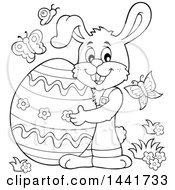 Black And White Lineart Happy Easter Bunny Rabbit Holding A Giant Egg