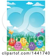 Group Of Happy Easter Eggs In Grass On A Spring Day