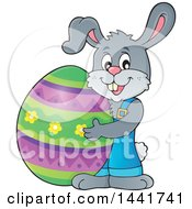 Clipart Of A Happy Gray Easter Bunny Rabbit Holding A Giant Egg Royalty Free Vector Illustration